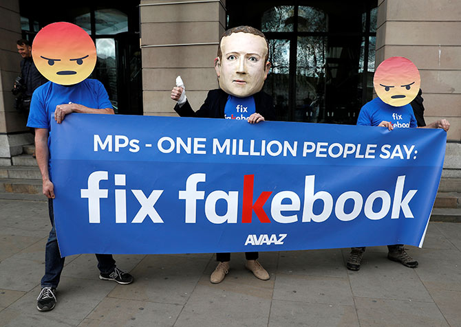Protesters from the pressure group Avaaz demonstrate against Facebook outside Portcullis House in Westminster, London, Britain, April 26, 2018.  Photograph: Peter Nicholls/Reuters.