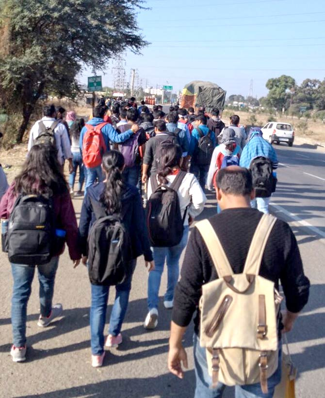 PhD and post graduate students at the Indian Institute of Technology Indore walk 18 km to the institute to highlight the withdrawal of institute buses