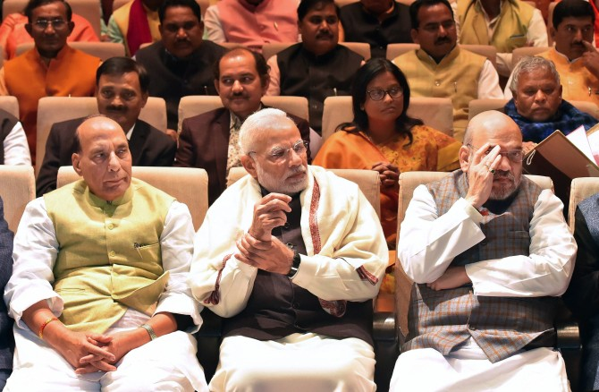 Prime Minister Narendra D Modi -- flanked by Bharatiya Janata Party President Amit A Shah, to his left, and Home Minister Rajnath Singh -- at the BJP Parliamentary Party meeting in New Delhi, February 1, 2018. Photograph: Atul Yadav/PTI Photo