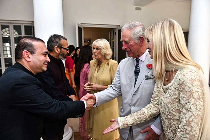 Jeweller Nirav Modi greets their royal highnesses, Prince of Wales and the Duchess of Cornwall at  the Elephant Parade India at the British High Commissioner's residence, New Delhi in November 2017. Photograph Courtesy Nirav Modi/Facebook.