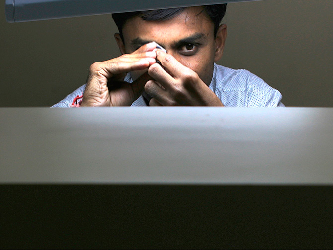 An employee works at a diamond cutting and polishing factory in Surat in the western Indian state of Gujarat March 3, 2009. Photograph: Arko Datta/Reuters.