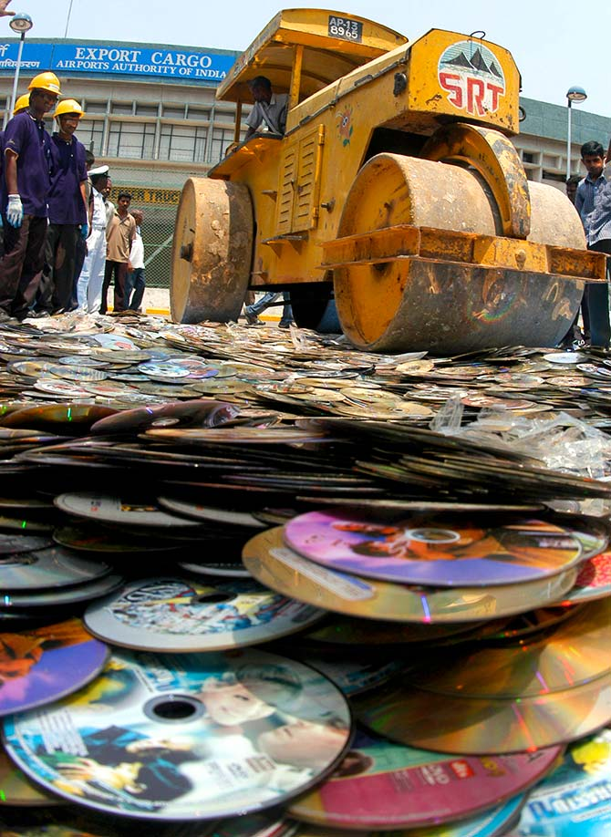Customs officials destroy about 35,000 pirated film DVDs confiscated at the airport, in the southern Indian city of Chennai March 23, 2007. Photograph: Babu/Reuters
