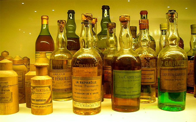 Bottles of fake French Chartreuse liqueur at their cellars at Voiron, Isère, France. Courtesy: TwoWings/Wiimedia Commons
