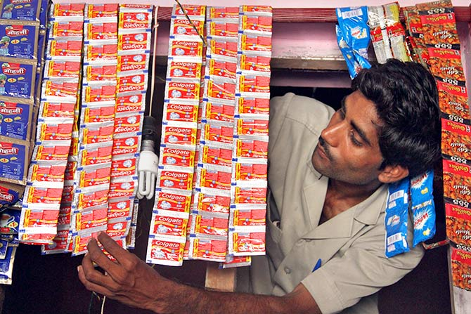 Posing with sachets of Colgate in Hargaon, Uttar Pradesh. Photograph: Pawan Kumar/Reuters