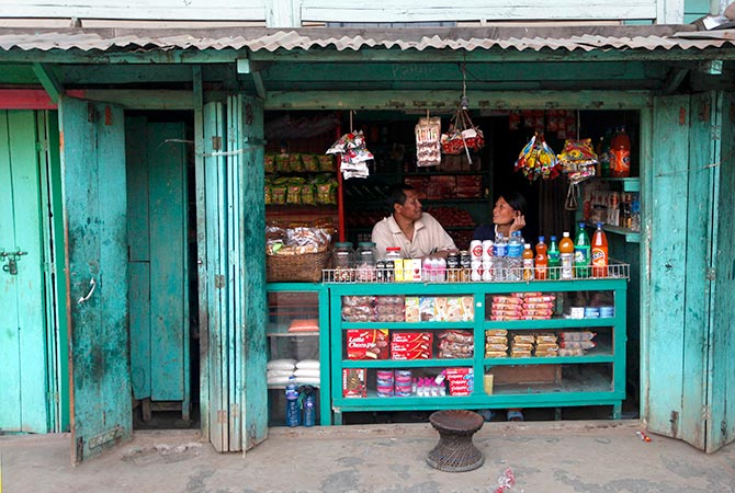 A couple runs a small store in Litan village, outside Imphal, Manipur. Photograph: Rupak De Chowdhuri/Reuters.