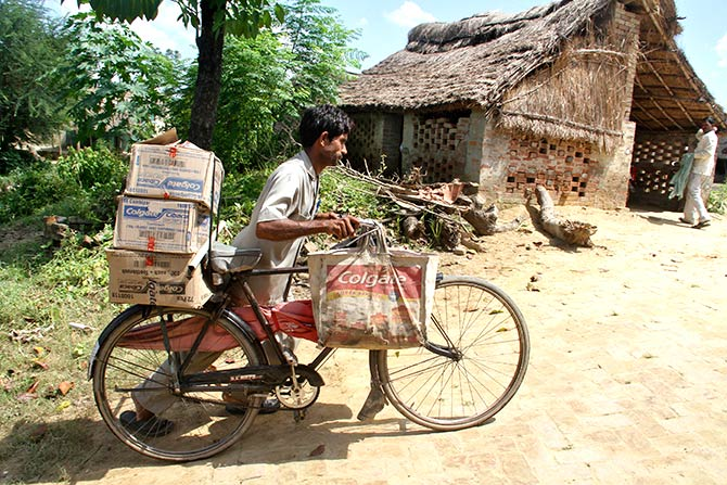 A wholesaler distributes his goods. Photograph: Pawan Kumar/Reuters.