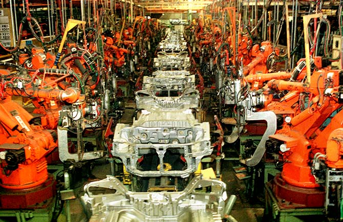 Robots and dozens of car chassis sit idley on an assembly line in Ulsan, South Korea's Hyundai Motors plant. Photograph: Reuters.