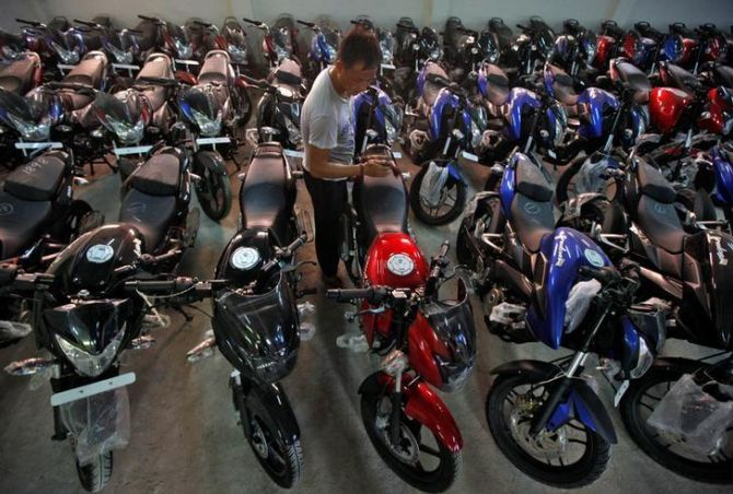 Motorcycles vroom past scooters on strong rural demand