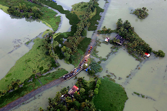 An aerial view shows partially submerged road at a flooded area in Kerala on August 19. Photograph: Sivaram V/Reuters.