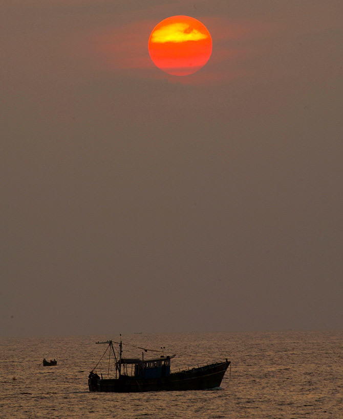 A fishing boat sits on the sea near Kovalam Beach, about 20 km (12 miles) south of Trivandrum, in Kerala. Photograph: Pawel Kopczynski/Reuters.
