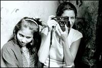 Zana Briski, with a friend