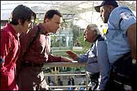 Diego Luna, Tom Hanks, Kumar Pallana and Chi McBride in DreamWorks' The Terminal - 2004.