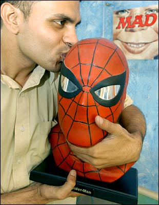 Studio Chief of Gotham Studios India, Jeevan J. Kang poses with a bust of comic-book hero Spider-Man at the Gotham Entertainment Group office in Bangalore