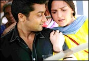 Surya and Esha Deol in Aayitha Ezhuthu