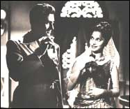 With Dev Anand in C.I.D.