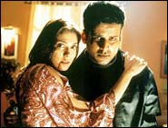 Ishaa Koppikar and Manoj Bajpai in Inteqam