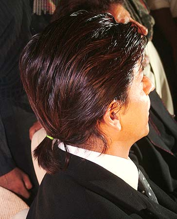 Shah Rukh Khan, with ponytail