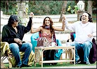 Amrita Arora with Abu Jani and Sandeep Khosla