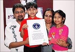 Master Kishan holds his Guinness certificate
