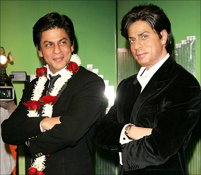 Shah Rukh Khan poses next to his newly unveiled waxwork at Madame Tussaud's, London