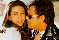 With Karisma Kapoor in this still from Hero No 1