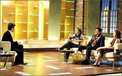 Karan Johar with Kajol, Shah Rukh Khan and Rani Mukerji on the sets of Koffee with Karan