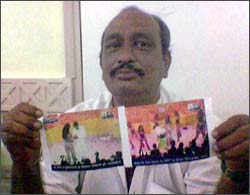 Vinod Jain displaying pictures of Mallika