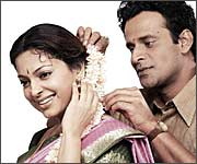 Juhi Chawla and Manoj Bajpai in Swami