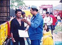 Director Suresh explains a shot to the superstar