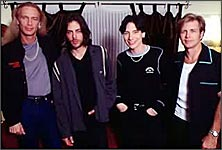 Eric Martin (third from left) with former band mates Mr Big.