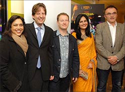 At the Mahindra Indo-American Arts Council Film Festival screening of the film in New York, seen from the left, Mira Nair, the producer of Slumdog Millionaire Christian Colson, writer Simon Beaufoy, co-director Loveleen Tandan and director Danny Boyle