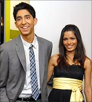 Dev Patel with Freida Pinto, actors from the film