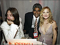 Musician Chris Robinson, Ashok and Kate Hudson.