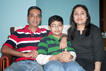 Sanjeev Hirani, Raju's brother, with his son Karan and wife Neetu