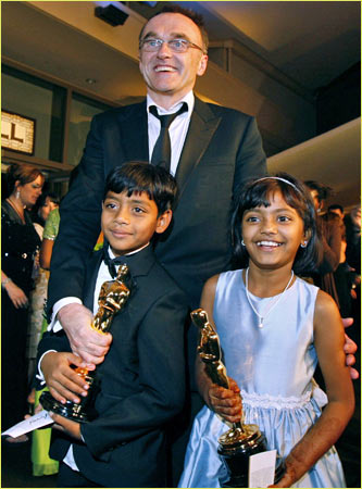 Danny Boyle celebrates with Azharuddin Ismail and Ayush Mahesh