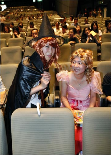 Fans in costumes pose before the screening of the world's first premiere of Harry Potter and the Half-Blood Prince in Tokyo