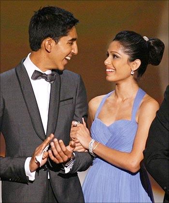 Dev Patel, Freida outfox paparazzi - Rediff.com movies фрида пинто