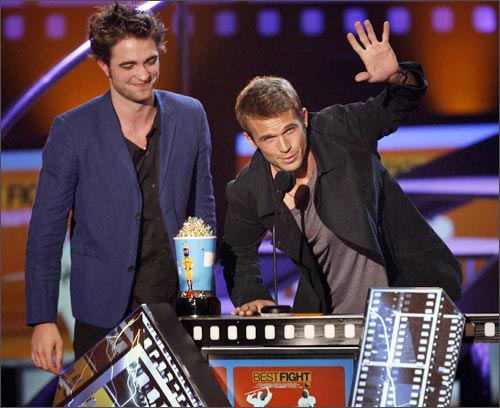 Cam Gigandet (right) speaks next to Robert Pattinson after they won the award for Best Fight.