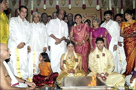 Tamil superstar Rajnikanth (behind the bride) was also spotted