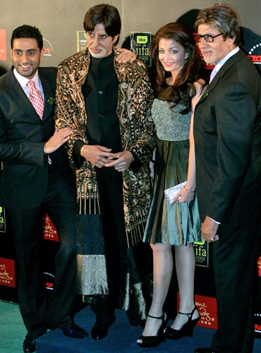 The Bachchans pose with the wax figure of Amitabh