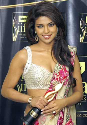 Priyanka Chopra poses with her award
