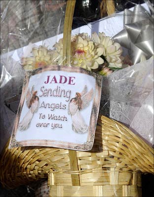 Flowers with a message of sympathy are left at the house of Jade Goody