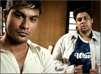 Kumal Khemu and Cyrus Broacha in a scene from 99