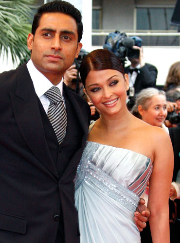 Abhishek and Aishwarya Rai Bachchan pose on the red carpet in Cannes