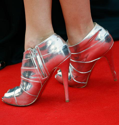 An unidentified guests' shoes are seen on the red carpet