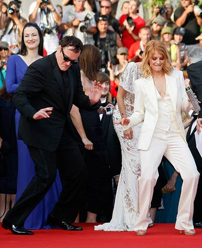 Quentin Tarantino dances on the red carpet with cast member Melanie Laurent