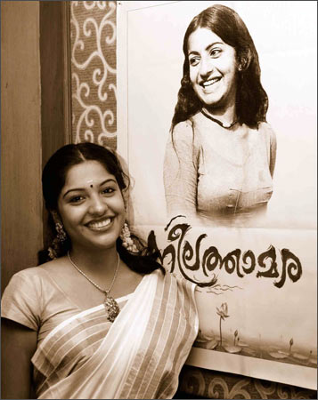 Archana with a poster of Ambika