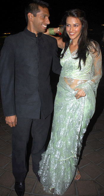Ritwik Bhattacharya and Neha Dhupia