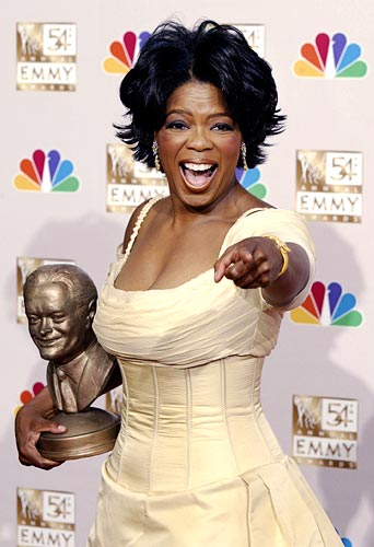 Oprah Winfrey displays her award at the 54th annual Emmy Awards in Los Angeles