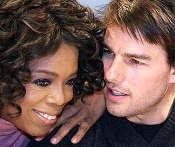 Oprah Winfrey shares a moment with actor Tom Cruise